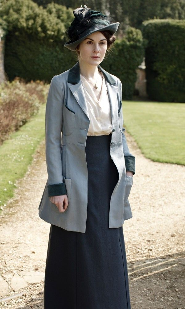 Lady Mary swaps her traditional dresses for a more modern skirt, blouse and jacket combo.