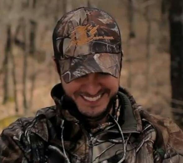That smile! and he is in camo! Perfection....