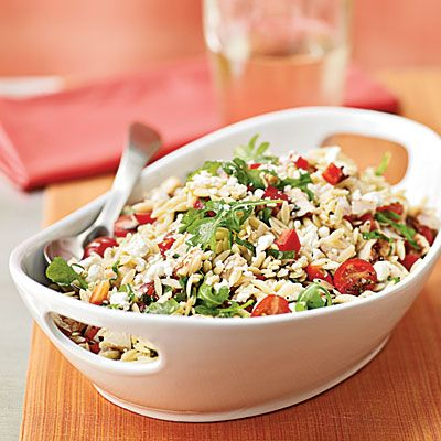 Chicken-Orzo Salad with Goat Cheese: this dish adds a base of orzo to fresh arugula, tomatoes, bell pepper, onion, and basil. Tangy goat cheese gives a luscious creaminess to each bite, and chopped chicken makes for a filling meal. Leave out the chicken and double the other ingredients for a picnic pasta salad that'll drive guests wild.