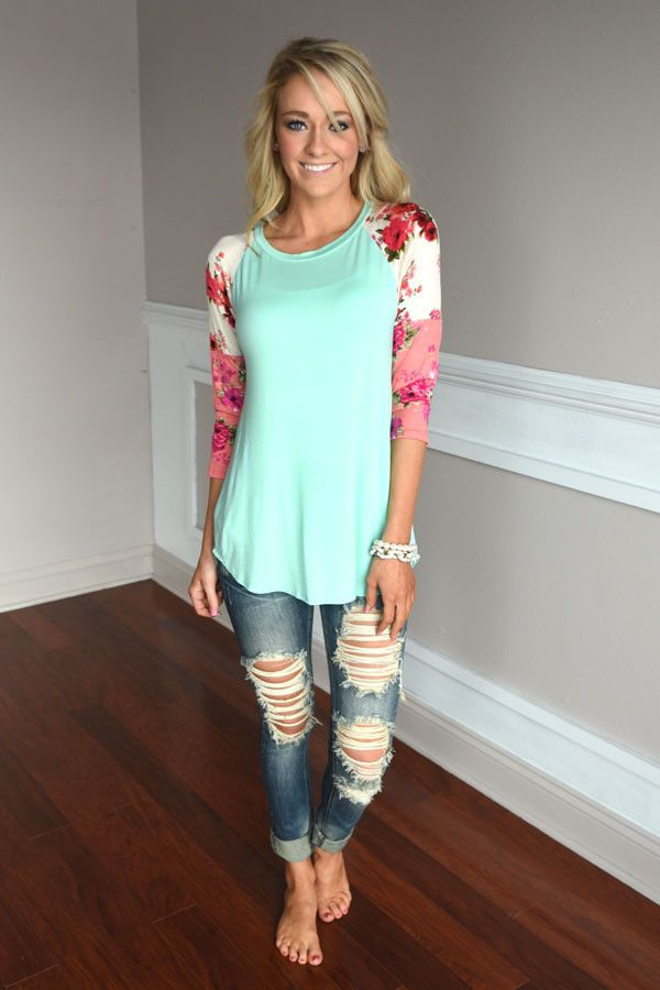 A fun mint top with ivory and pink sleeves. True to size with a looser fit. Model is 5'5'' a...