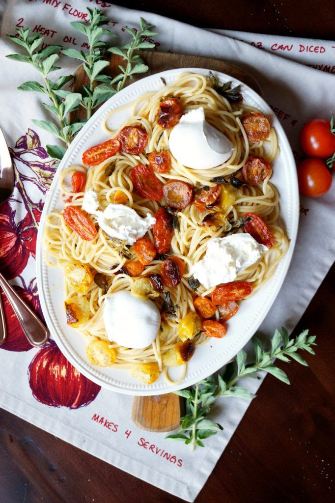 Make your weeknight dreamy with this Roasted Cherry Tomato and Burrata Pasta! Charred baby tomatoes are tossed with spaghetti and cheese for a quick dinner.