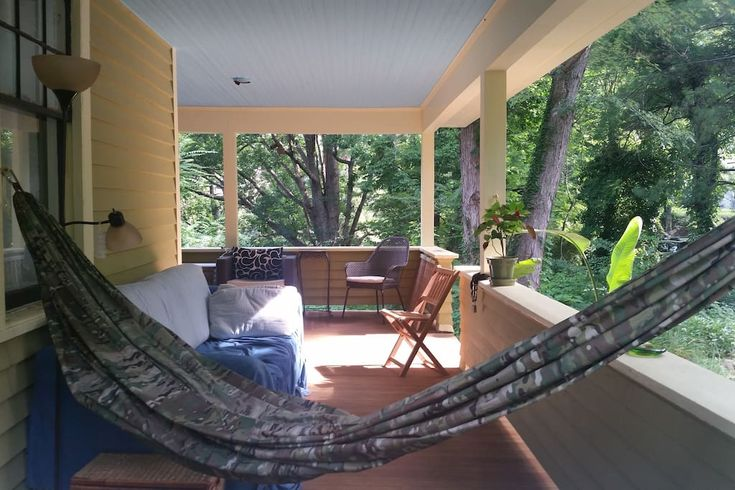 Entire home/apt in Asheville, United States. Can sleep 8 in beds/pullout or more on dreamtime (provided) camping mats Great beds. Peaceful sleeping! Large craftsman home. Spacious upstairs apt: 2.5 bedroom/2 bath, private sunny kitchen & living room. Surrounded on 3 sides by trees/green sp...