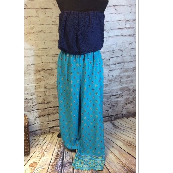 ‼️$10 OFF TONIGHT‼️ Liberty Love Aztec Jumpsuit Pretty strapless Aztecs print jumpsuit with a lace style top and palazzo bottom. JUNIOR SIZING 2nd photo shown for fit and style only Liberty Love Pants Jumpsuits & Rompers