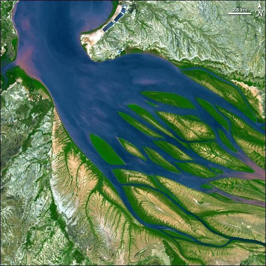 Madagascar's Bombetoka BayCredit: NASAOn the northwestern coast of Madagascar, the salty waters of the Mozambique Channel penetrate inland to join with the freshwater outflow of the Betsiboka River, forming Bombetoka Bay. Numerous islands and sandbars have formed in the estuary from the large amount of sediment carried in by the Betsiboka River and have been shaped by the flow of the river and the push and pull of tides.