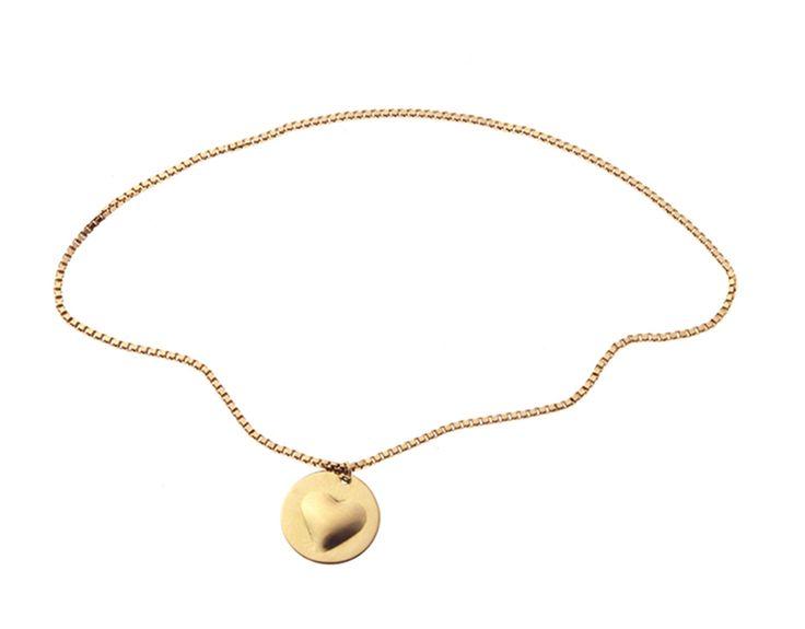 Bracciale L'Essenziale saldato direttamente sul polso e  charm Mignon oro 18kt. Atelier VM