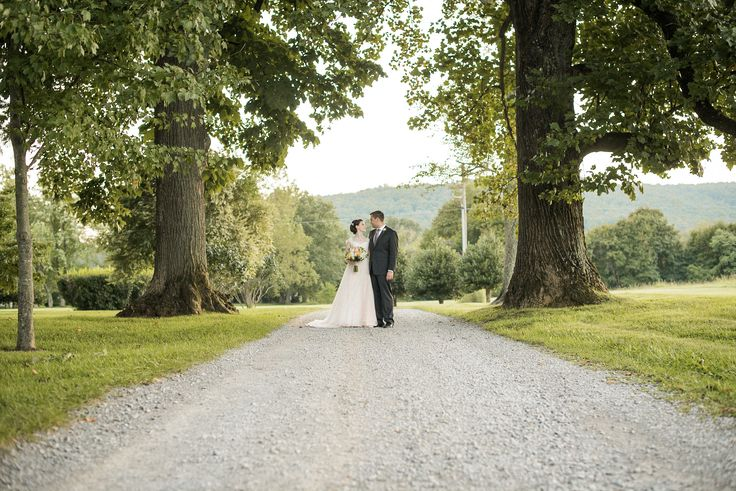 The gravel drive, the towering trees, the elegant couple...this is Southern chic #wedding at its finest!