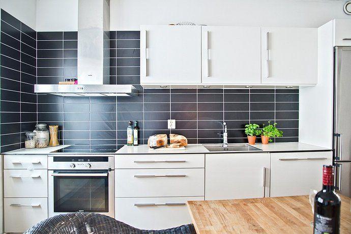 small kitchen black tiles white