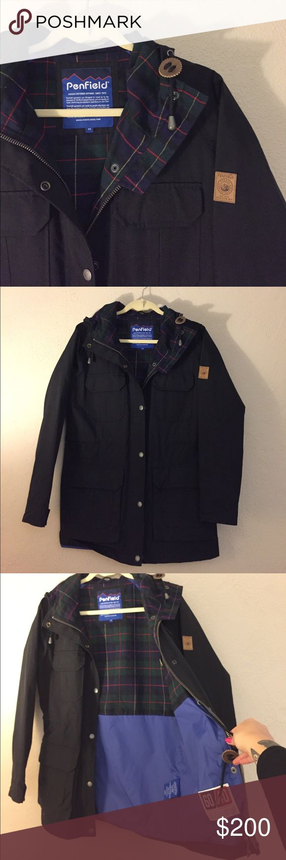Penfield Kasson Black Parka Jacket Medium Never worn outside of my house and in perfect condition. This is a version of their iconic Kasson parka from 2012. The interior has a plaid lining on the top half and blue material on the bottom. These parkas have alot of pockets to stash your items and there's even one on the back of the jacket and inside. To adjust the waist there is an internet drawstring. Please ask if you have any questions about sizing. Penfield Jackets & Coats