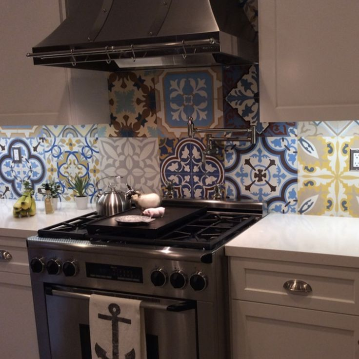 Patchwork #cementtiles add the right amount of delight to your #kitchen #backsplash #design. #TileTuesday