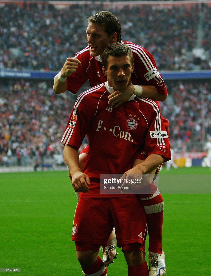 Lukas Podolski of Bayern Munich celebrates after scoring a goal with his team mate Bastian Schweinsteiger during the Bundesliga match between FC Bayern Munich and Hertha BSC Berlin at the Allianz Arena on October 14, 2006 in Munich, Germany.