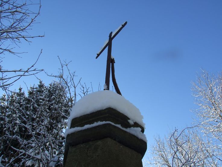 Cross on the Czech- Polish border in Krkonoše mountain near Albeřice village.