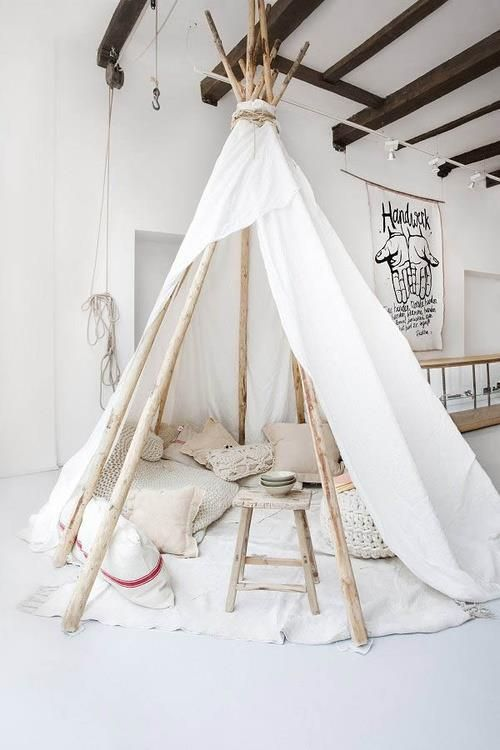 How cool is this tent reading nook? We'd love to have this in our childhood (or adult) bedroom.