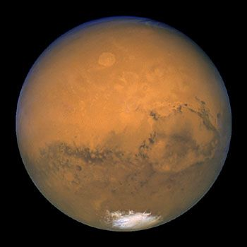 Mars- This image was taken within minutes of Mars' closest approach to Earth in 60,000 years, on Aug. 27, 2003. In this picture, the red planet is 34,647,420 miles (55,757,930 km) from Earth.