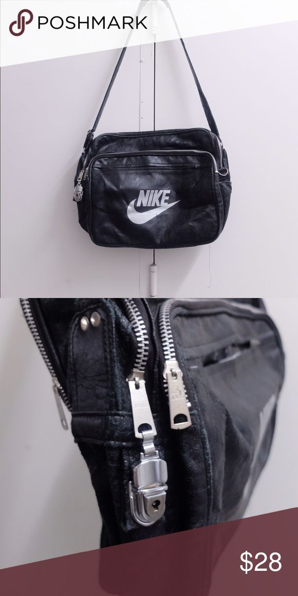 Vintage Nike Shoulder Bag In great vintage condition. Lots of compartments with zippers provide lots of storage. Nike Bags Crossbody Bags