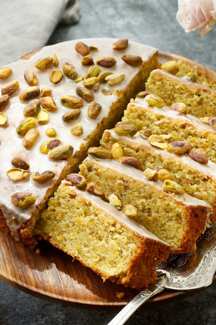NYT Cooking: This fantastically moist pistachio cake, adorned with the simplest icing of confectioners' sugar and lemon juice, is adapted from Nigel Slater, the prolific British cookbook author. It is elegant and slightly exotic, rich with ground pistachios and almonds, orange zest and rosewater. And it's delightfully simple to throw together: once you've ground the nuts, you'll have it in t...