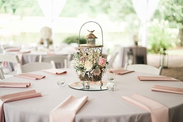 Floral lantern centerpiece | Blush pink and gray place settings and tablescape…