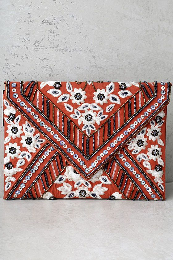 """The Gleaming Arrangement Rust Orange Beaded Clutch is sure to catch anyone's eye! This woven envelope clutch is artfully decorated with beige floral embroidery, plus gold and gunmetal beads and sequins. Lift top from the magnetic closure to reveal a satiny interior and side wall pocket. Carry as a clutch, or attach the 46"""" shiny gold chain strap."""