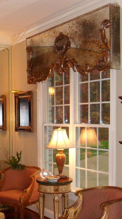 Window Cornice of antique mirror. This doesn't really go with my house, but I love it!
