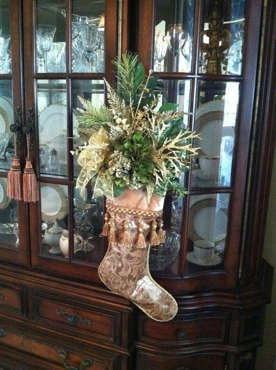 Christmas Stocking Wreath by Greatwood Floral Designs. Green Hydrangea, gold glitter accents in pretty tassel stocking.