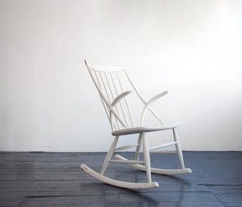 Late 50's rocker designed by Illum Wikkelso and manufactured by Ejlersen
