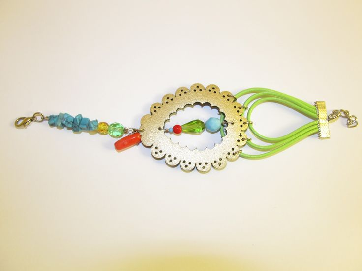 Handmade leather bracelet (1 pc)  Made with gold laser cut leather filigree, leather cords, coral, turquoise chips and glass beads.