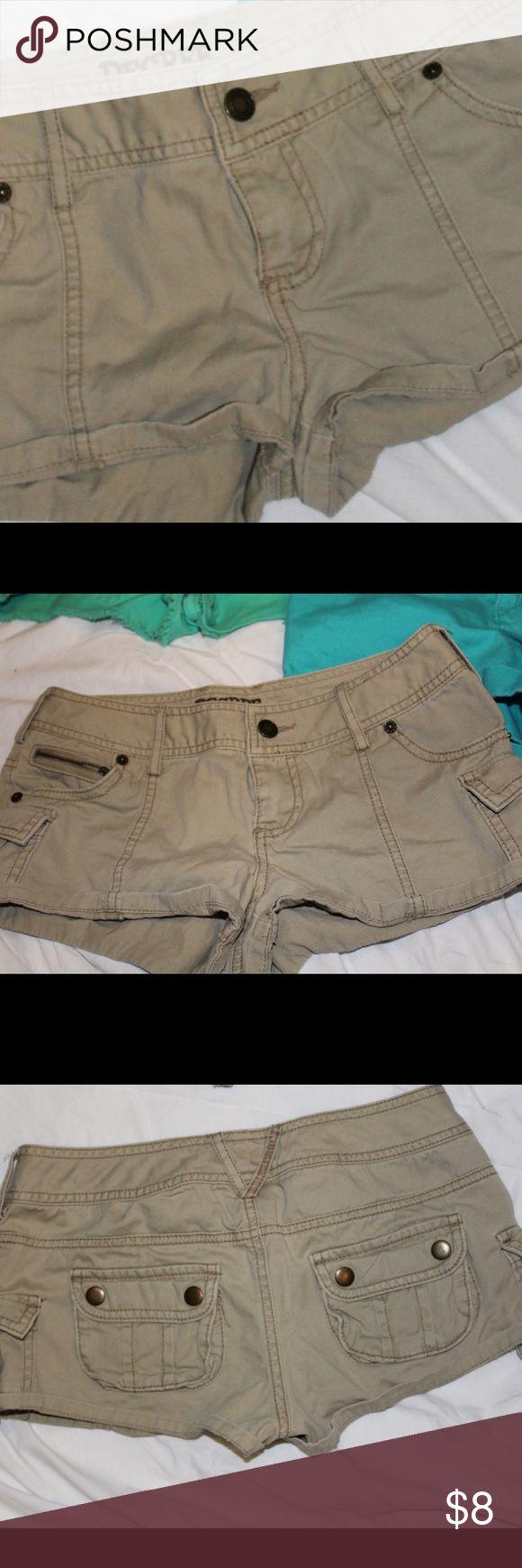 Khaki Military Shorts Khaki military inspired shorts in a size 3/ 26. Decree Shorts Jean Shorts