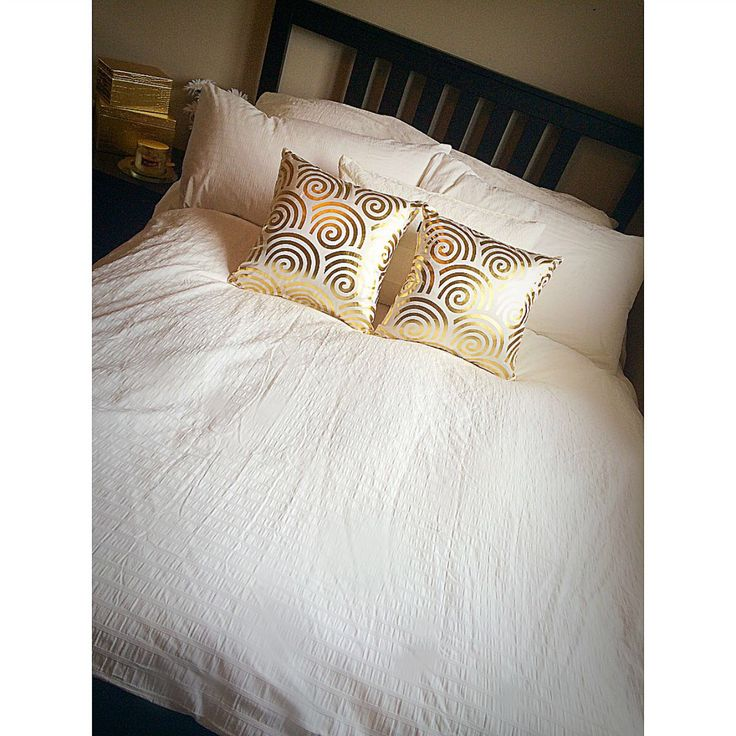 my bedding. duvet cover & white pillows from ikea. gold pillows from fabricland.