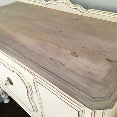 Weathered top. I used Annie Sloan's old white chalk paint, minwax stain in special walnut and general finishes Java gel stain.