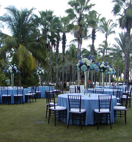 Blue tall centerpieces table settings wedding reception