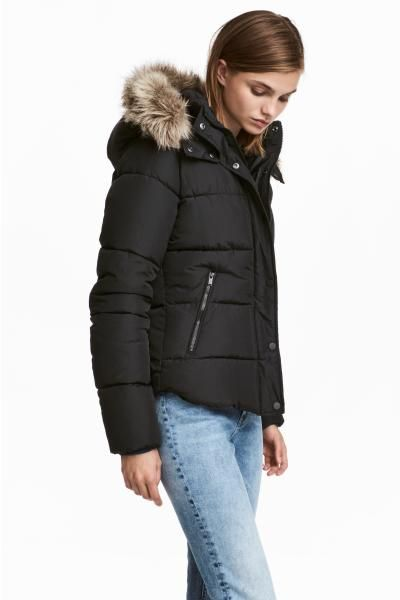 Padded jacket with lined, faux fur-trimmed hood and stand-up collar. Wind flap with press-studs down the front and zipped side pockets. Lined.