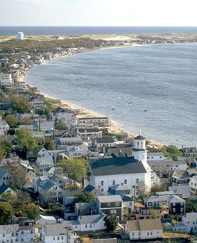 Provincetown, Cape Cod Mass. This view is stunning when the sun is setting and you are sailing back into the harbor... all of the lights come on to welcome you in.  Ah, blissful!
