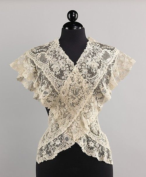 Beautiful lace Fichu from the 19th century. A fichu is a large, square kerchief worn by women in the 18th century to fill in the low neckline of a bodice. The fichu was generally of linen fabric and was folded diagonally into a triangle and tied, pinned, or tucked into the bodice in front.