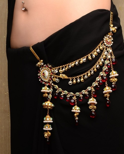 "Ethnic kundan kandora.  not only this adds to the charm of an ethnic attire, but if it is heavy enough (<100gms) & the hook is 3"" long & 1"" wide (approx) & it is inserted about 1.5 to 2"" apart from the center line of the body, the hook activates acupressure points related to the throat, and acts to keep it clear of phlegm, so that the voice remains clear, & becomes easier to clear if required. It's a boon for women who need to clear their throat frequently."
