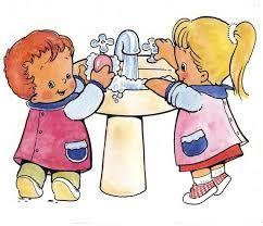 Two children washing their hands.