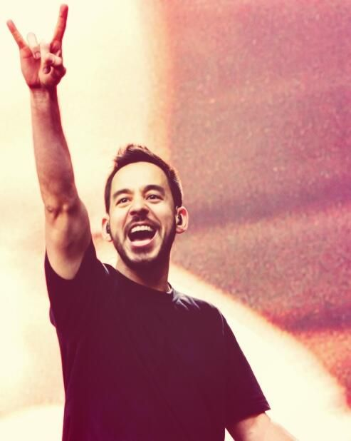 mike shinoda of linkin park rock on sign.