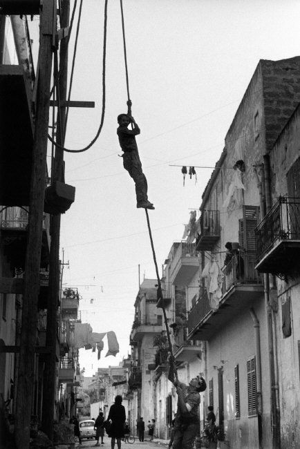 Ferdinando Scianna, Italy, Sicily, Bagheria:Young bricklayer in a dangerous work