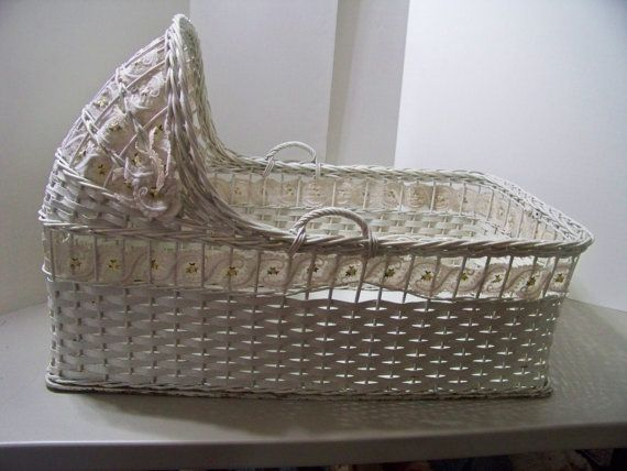 Wicker Baby Bassinet with Handles. I had one like this on a chrome stand with a beautiful frilled lining.Mine was more rounded on the foot end.