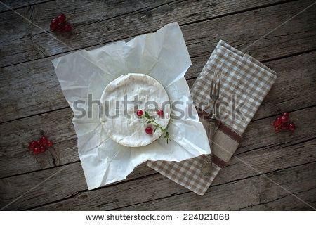 #Overhead #shot of #Camembert #cheese on piece of paper, decorated with #redcurrants and #thyme. - #stockphoto #Shutterstock