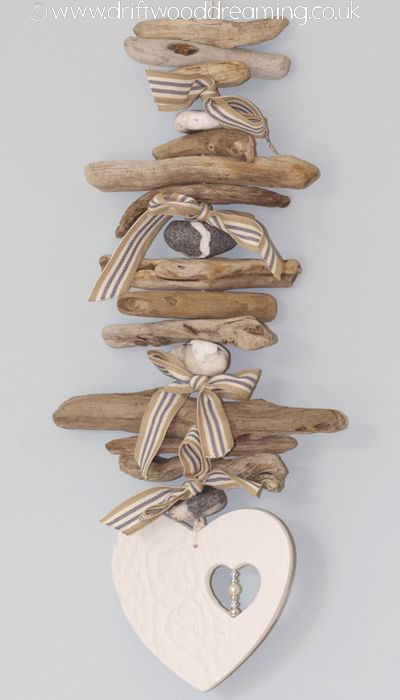 Love this cute little driftwood hanger with heart-cutout-in-heart dangle - adorable! #beach #decor