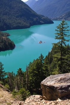 Diablo Lake is a reservoir in the North Cascade mountains of northern Washington state, USA. Created by Diablo Dam, the lake is located between Ross Lake and Gorge Lake on the Skagit River at an elevation of 1,201 feet (366 m) above sea level. Diablo Lake is part of the Skagit River Hydroelectric Project and managed by Seattle City Light.