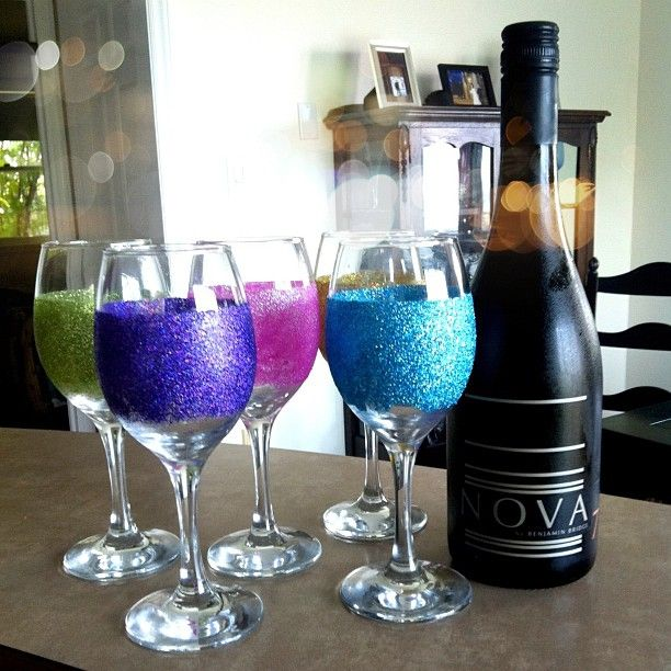 DIY Glitter Wine Glasses! Buy some cheap wine glasses, and glitterfy your wine glasses in a few easy steps. Great for non-boring wine lovers like myself!!