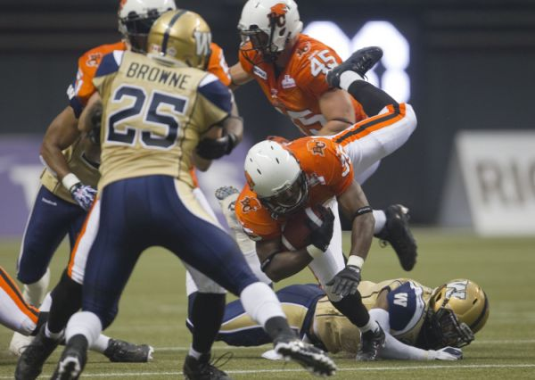 BC Lions running back Tim Brown runs the ball against the Winnipeg Blue Bombers during the first half of their CFL football game in Vancouver, British Columbia, June 29, 2012.