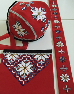 Beaded embroidery on a Hardanger bunad set for a little girl. Handmade by Lill Venke Hustvedt