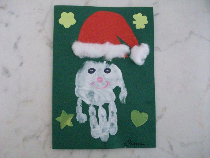 peinture sur carton | Peindre la main de l'enfant avec de la gouache blanche.