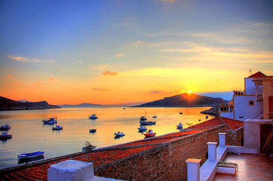 Halki Sunrise by Tom Gomez  Sunrise seen from the village of Nimborio on the Greek Island of Halki (Chalki).  Halki is a small yet very charming island in the Dodecanese that is situated opposite the west coast of Rhodes.