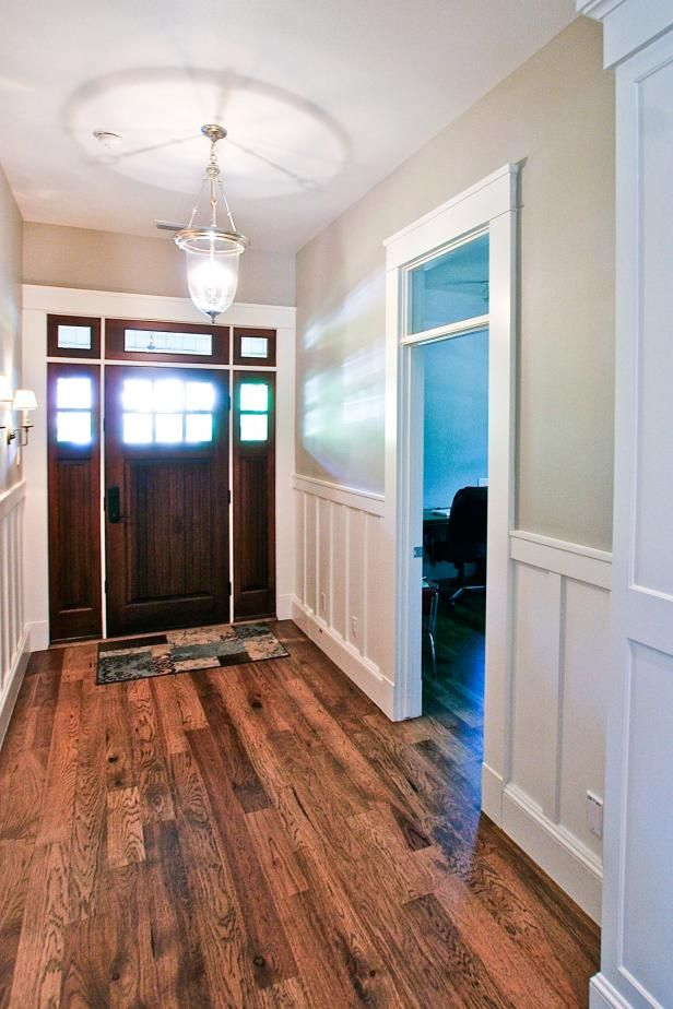 Neutral Craftsman Foyer With Dark Wood Door Amp White