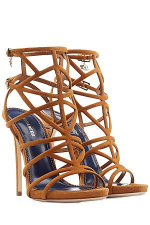 The wisp-thin straps on these Dsquared2 sandals are made sophisticated in caramel colored suede. Delicate logo charms and a pencil-thin stiletto add glamor #Stylebop