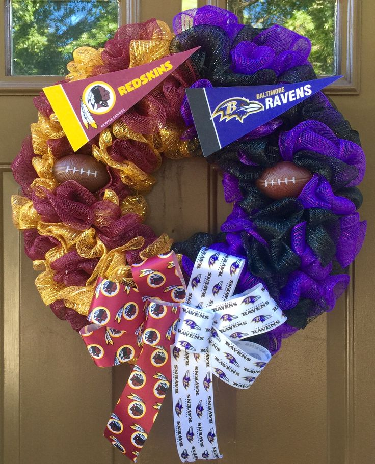 A house divided! This 23 inch Deco Mesh Wreath with Handmade Bow and Embellishments representing my hometown teams the Washington Redskins and the Baltimore Ravens. Can be designed for any 2 teams. Visit my Facebook page, www.facebook.com/theoccasionalwreath or contact me via email at theoccasionalwreath.kim@gmail.com to place your custom order.