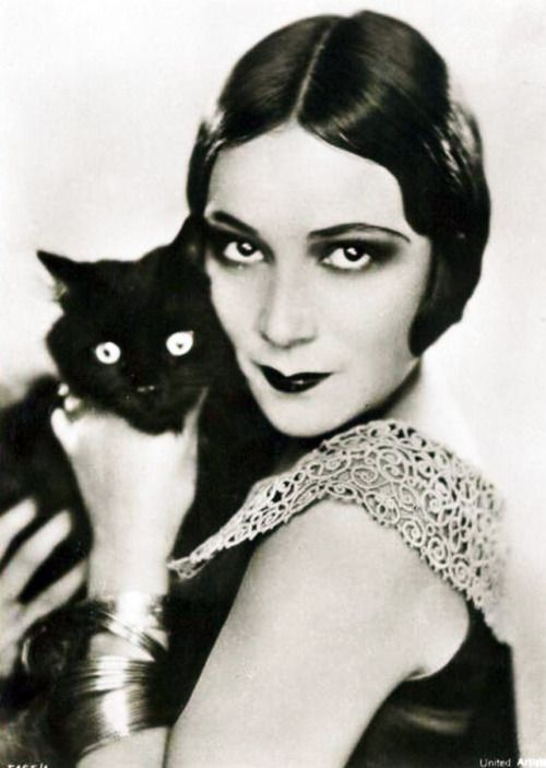 Dolores Del Rio and black cat