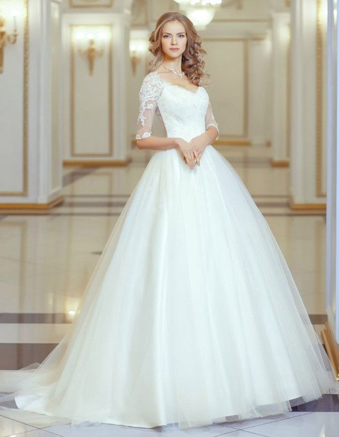 Lace Embroidered Bodice Illusion Neck High Low Ball Gown Tulle Wedding Dress with Long Lace Sleeves Fabric: lace,Tulle Silhouette:Ball Gown Hemline/High Low Trend Collections: 2016 Collection Dry clea